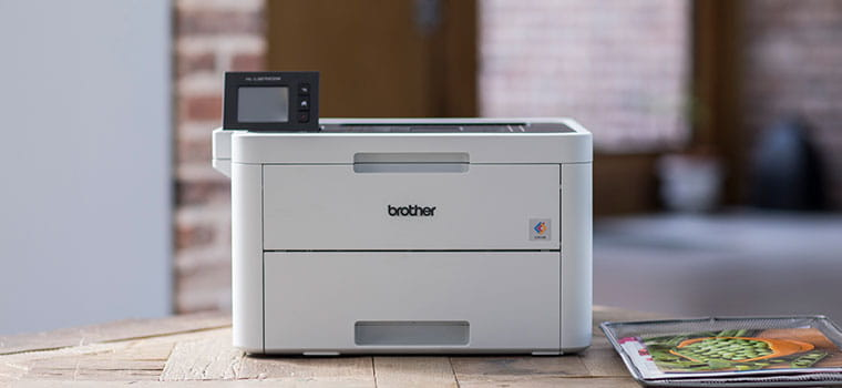 Laserskrivare på bord Brother