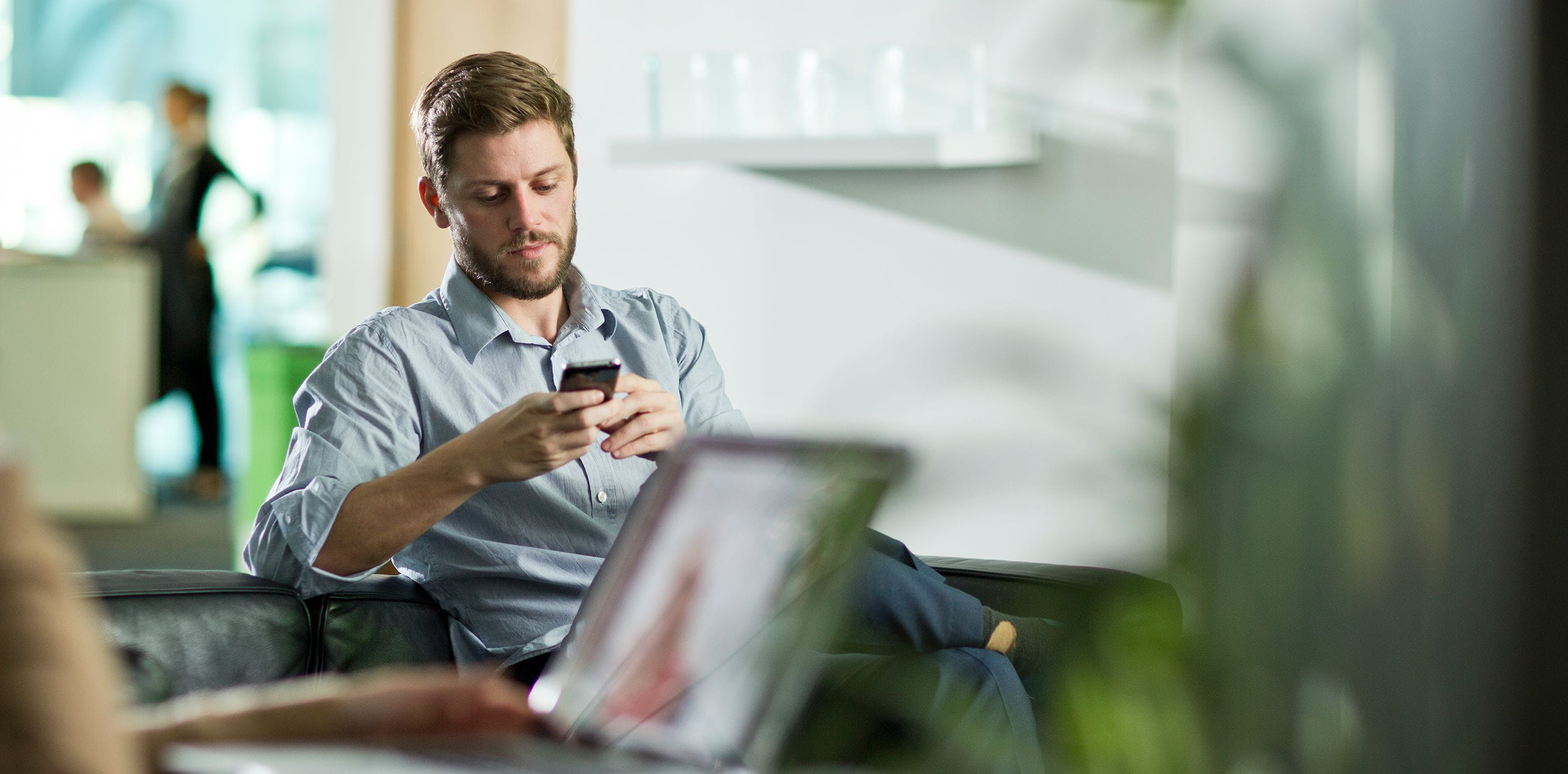 Brother OmniJoin man on phone in office waiting room