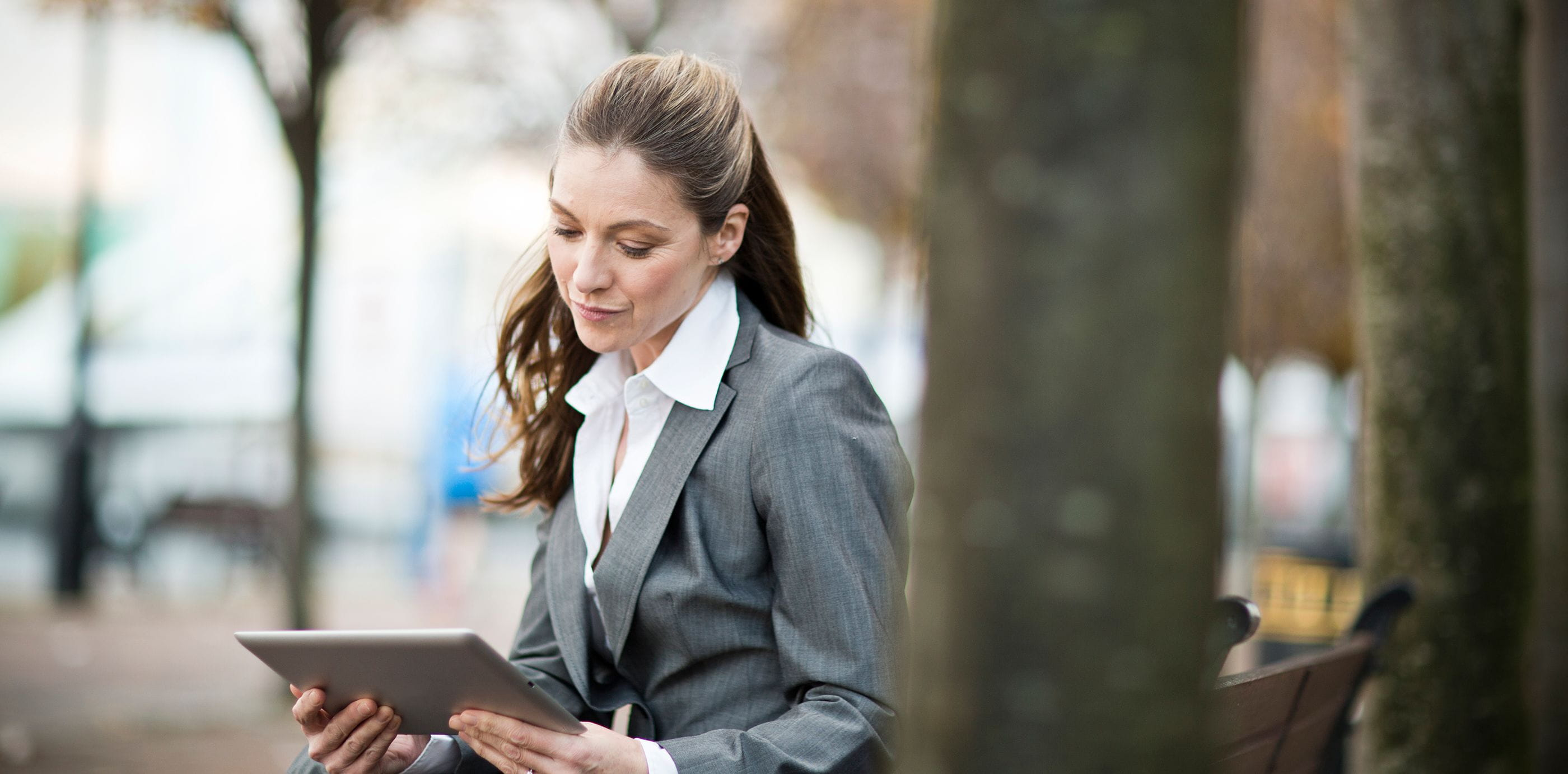 Brother OmniJoin woman outside working on tablet