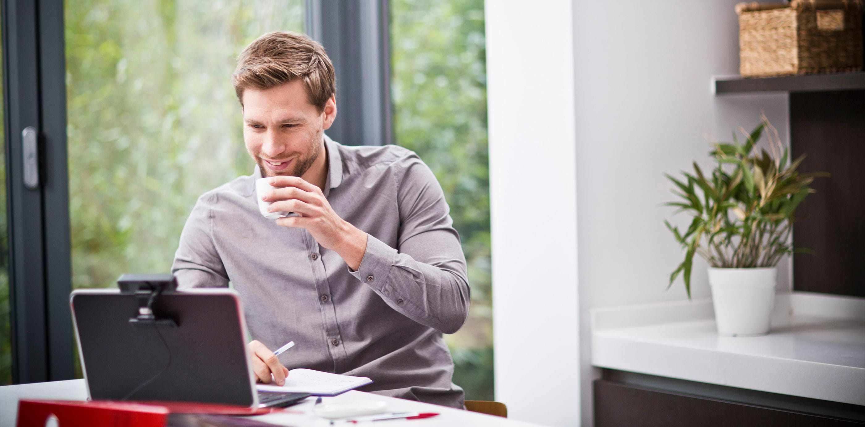 Brother OmniJoin man at home in web conference on laptop